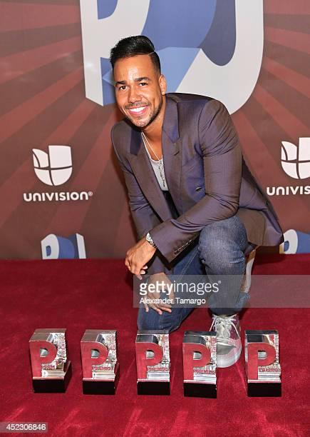 Romeo Santos poses with his awards in the press room during the Premios Juventud 2014 at The BankUnited Center on July 17 2014 in Coral Gables Florida