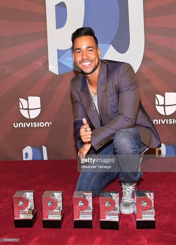 Romeo Santos poses with his awards in the press room during the Premios Juventud 2014 at The BankUnited Center on July 17, 2014 in Coral Gables, Florida.