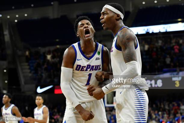 Romeo Weems and Paul Reed of the DePaul Blue Demons react after their defensive stop in overtime of the game against the Texas Tech Red Raiders at...
