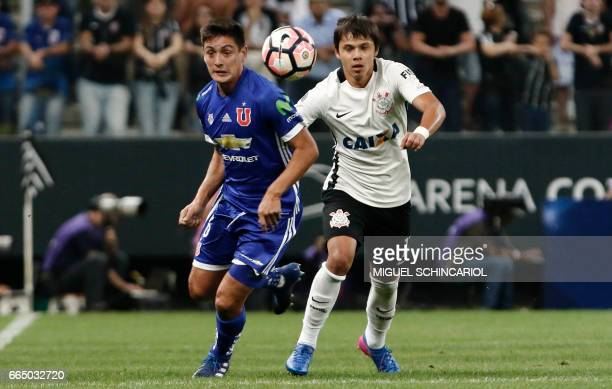 Romero of Brazil Corinthians vies for the ball with MRodriguez of Chile's Universidad de Chile during their 2017 Sudamericana Cup football match held...