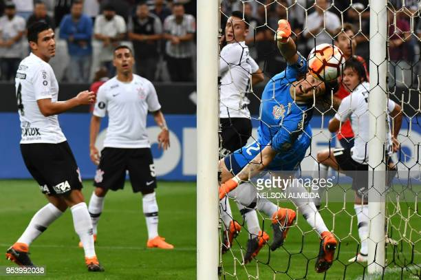 Romero of Brazil's Corinthians heads the ball to score an own goal against of Argentina's Independiente during their 2018 Copa Libertadores football...