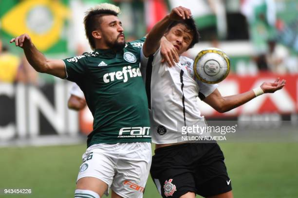 Romero of Corinthians vies for the ball with Vitor Luis of Palmeiras during their 2018 Paulista championship final football match held at Allianz...