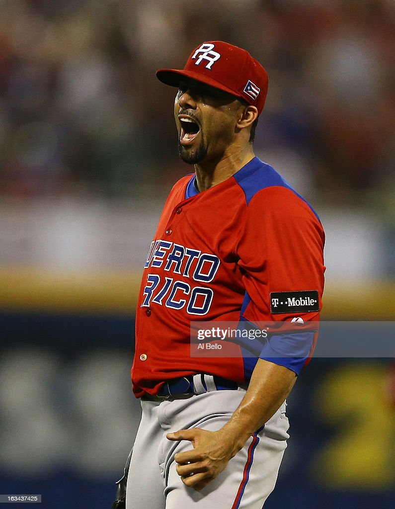 J.C. Romero #32 of Puerto Rico celebrates after retiring the side after the eighth inning against Venezuela during the first round of the World Baseball Classic at Hiram Bithorn Stadium on March 9, 2013 in San Juan, Puerto Rico.