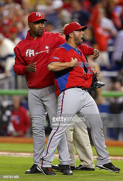 C Romero of Puerto Rico reacts to winning a World Baseball Classic second round game against the United States at Marlins Park on March 15 2013 in...