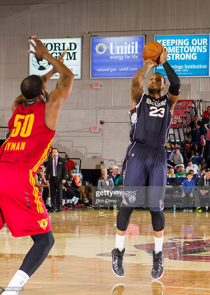 Romero Osby #23 of the Maine Red Claws puts up a jump shot over Travis Hyman #50 of the Fort Wayne Mad Ants during Playoff Game #2 on April 11, 2015 at the Portland Expo.