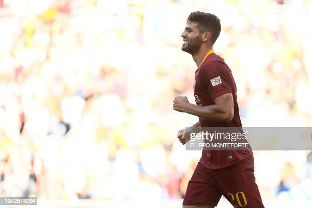 AS Rome's Argentine defender Federico Fazio celebrates after scoring his team's third goal during the Italian Serie A football match AS Rome vs Lazio...