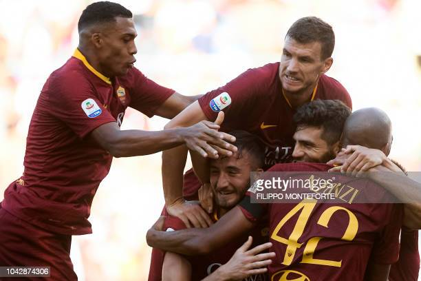 AS Rome's Argentine defender Federico Fazio celebrates with AS Rome's Bosnian forward Edin Dzeko and teammates after scoring his team's third goal...