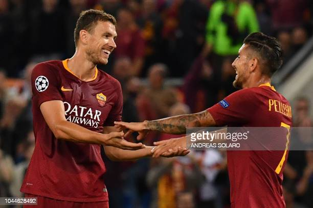 AS Rome's Bosnian forward Edin Dzeko celebrates with AS Rome's Italian midfielder Lorenzo Pellegrini after scoring his second goal during the UEFA...