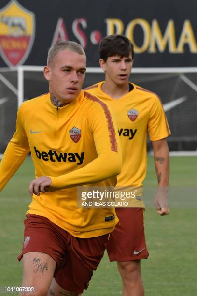 AS Rome's Dutch defender Rick Karsdorp and AS Rome's Croatian midfielder Ante Coric take part in a training session on the eve of the UEFA Champions...