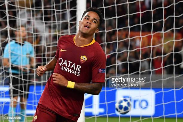 AS Rome's Dutch forward Justin Kluivert celebrates after scoring during the UEFA Champions League group G football match between AS Roma and FC...