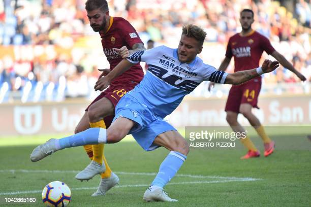 AS Rome's Italian defender Davide Santon and Lazio's Italian forward Ciro Immobile go for the ball during the Italian Serie A football match AS Rome...