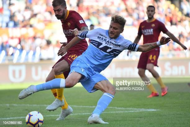 AS Rome's Italian defender Davide Santon and Lazio's Italian forward Ciro Immobile go for the ball during the Italian Serie A football match AS Rome...