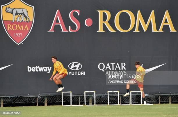 AS Rome's Italian defender Luca Pellegrini and AS Rome's Croatian midfielder Ante Coric take part in a training session on the eve of the UEFA...
