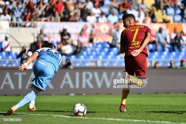 AS Rome's Italian midfielder Lorenzo Pellegrini opens the scoring with a back heel kick during the Italian Serie A football match AS Rome vs Lazio...