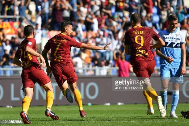AS Rome's Italian midfielder Lorenzo Pellegrini reacts after opening the scoring with a back heel kick during the Italian Serie A football match AS...