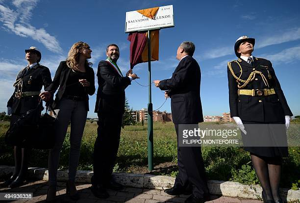 Rome's Mayor Ignazio Marino and Chile's ambassador Fernando Ayala unveil a plaque during the inauguration of a square named after Chile's former...