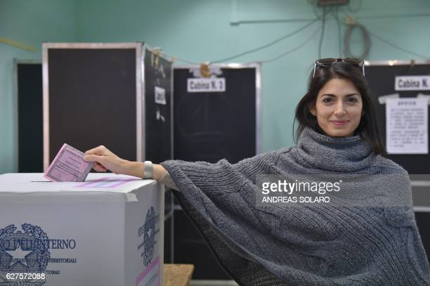 Rome's Mayor Virginia Raggi casts her ballot for a referendum on constitutional reforms, on December 4, 2016 in Rome. Italians began voting today in...