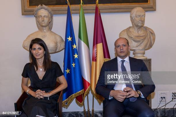 Rome's Mayor Virginia Raggi receives with the Director General of As Roma Mauro Baldissoni during a press conference at Rome's Capitol Hill on August...