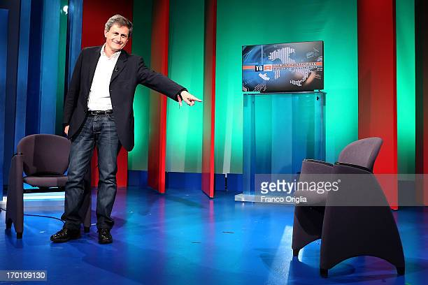 Rome's outgoing mayor and mayoral candidate for the CentreRight coalition Gianni Alemanno shows the empty seat of his competitor in Rome's mayoral...