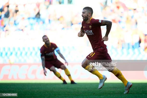 AS Rome's Serbian defender Aleksandar Kolarov celebrates after scoring his team's second goal during the Italian Serie A football match AS Rome vs...