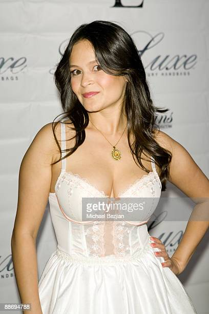 Romi Dames attends the LaurenElaine designs runway event at Le Doux on June 25 2009 in Los Angeles California