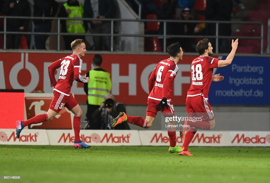 Romian Bregerie (R) of FC Ingolstadt and his teammates celebrate their side's second goal during the Bundesliga match between FC Ingolstadt 04 and 1. FC Koeln at Audi Sportpark on March 11, 2017 in Ingolstadt, Germany.