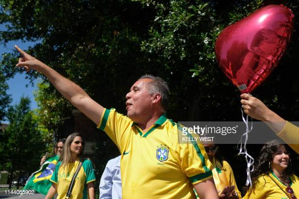 Romildo Ferreira shouts to protestors across the driveway as protesters and supporters of the Brazilian president gather outside the Old Parkland...