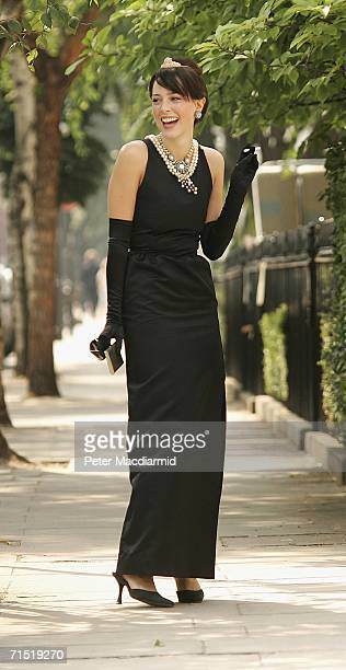 Romilly Collins from Christie's models an original Givenchy dress worn by Audrey Hepburn in the film 'Breakfast at Tiffany's' on July 26 2006 in...