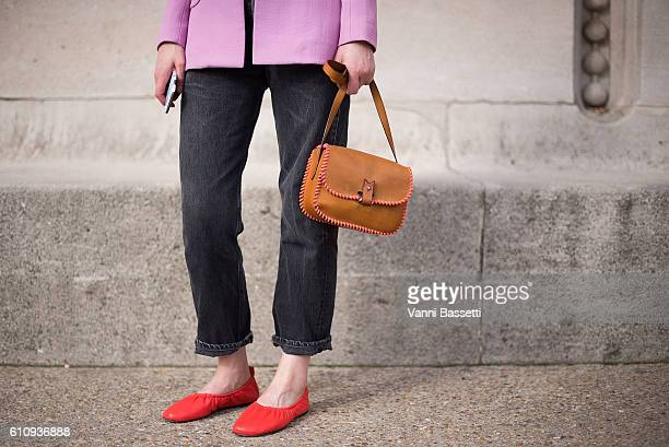Romilly Mason poses wearing a Roksanda coat Celine shoes and La Contrie bag after the Maison Martin Margiela show at the Grand Palais during Paris...