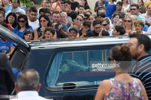Romina Sala sister of Emiliano Sala kisses her late brother's coffin as it is being place in the hearse to take it to Santa Fe after a vigil at...