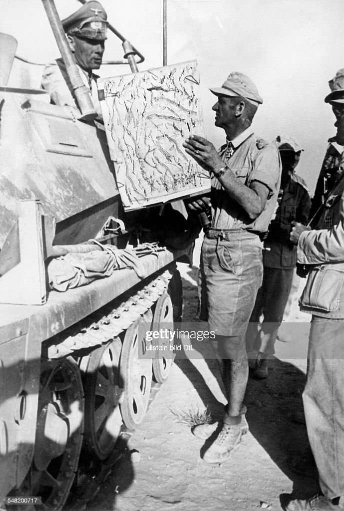Rommel, Erwin 1891-1944 officer (gen.field marshall), germany commander of afrikacorps feb1941-march43 Col.Gen. Rommel in his armoured command post vehicle issuing orders during the offensive direction Ghazala. May/June 1942 : News Photo