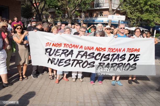 Rommy Arce Councilor of Now Madrid and Raul Camargo deputy in the Assembly of Madrid seen together with people holding a banner during a...