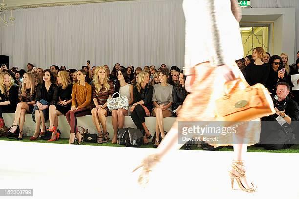 Romola Garai Joanne Froggatt Elizabeth McGovern Gillian Anderson Olivia Palermo Vanessa Kirby Lana Del Rey Kate Moss and Alexa Chung sit in the front...