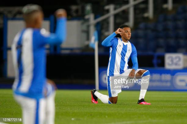 Romoney Critchlow of Huddersfield Town takes the knee during the Sky Bet Championship match between Huddersfield Town and Nottingham Forest at John...