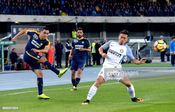 Romulo Caldeira of Hellas Verona FC competes with Yuto Nagatomo of FC Internazionale during the Serie A match between Hellas Verona FC and FC...