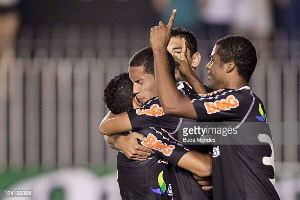 Romulo Eder Luis, Diego Silva and Renato Silva of Vasco celebrate a scored goal against Coritiba during a match as part of Serie A 2011 at Sao...
