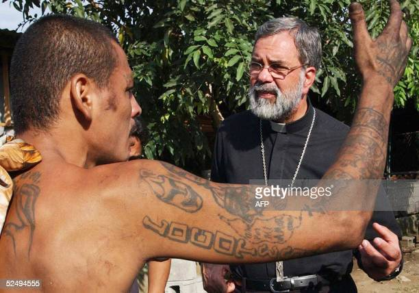 Romulo Emiliani Archbishop of San Pedro Sula speaks with a member of the Salvatrucha gang in San Pedro Sula Honduras 26 March 2005 Violence from...