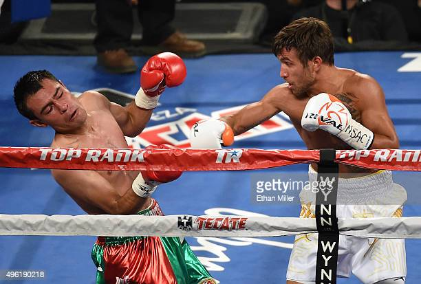 Romulo Koasicha falls back from a punch by Vasyl Lomachenko in the third round of their WBO featherweight title fight at the Thomas Mack Center on...