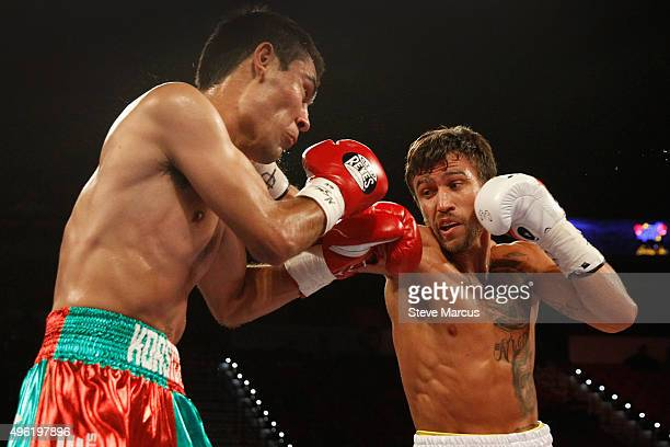 Romulo Koasicha takes a punch from WBO featherweight champion Vasyl Lomachenko during their title fight at the Thomas Mack Center on November 7 2015...