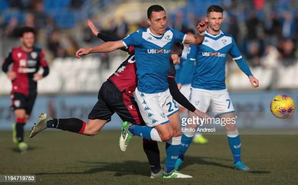 Romulo of Brescia Calcio competes for the ball with Marko Rog of Cagliari Calcio during the Serie A match between Brescia Calcio and Cagliari Calcio...