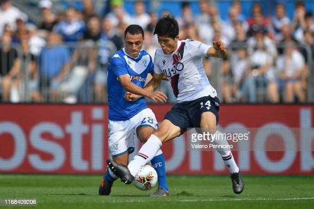 Romulo of Brescia Calcio competes with Takehiro Tomiyasu of Bologna FC during the Serie A match between Brescia Calcio and Bologna FC at Stadio Mario...