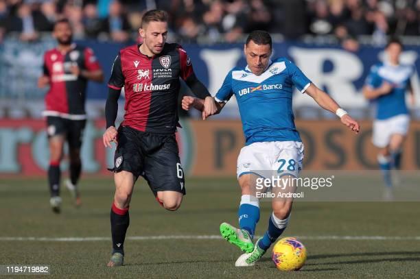 Romulo of Brescia Calcio is challenged by Marko Rog of Cagliari Calcio during the Serie A match between Brescia Calcio and Cagliari Calcio at Stadio...