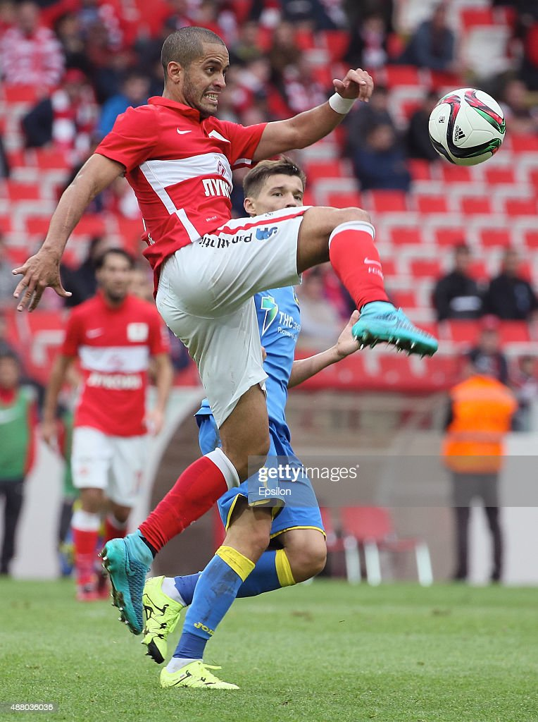 Romulo of FC Spartak Moscow challenged by Dmitry Poloz of FC Rostov Rostov-on-Don during the Russian Premier League match between FC Spartak Moscow v FC Rostov Rostov on Don at the Arena Otkritie stadium on September 13, 2015 in Moscow, Russia.