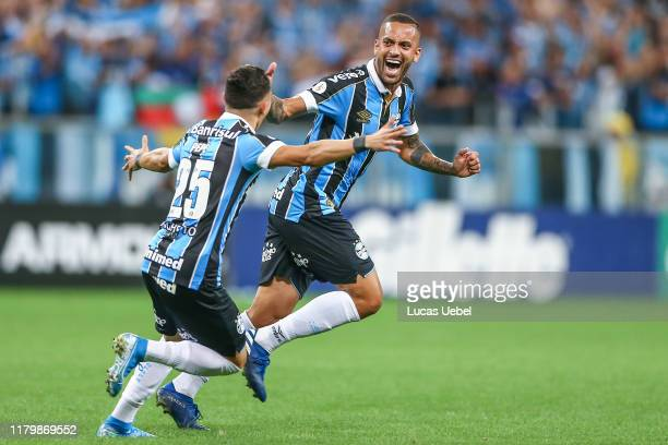 Romulo of Gremio celebrates their second goal during the match between Gremio and Internacional as part of Brasileirao Series A 2019 at Arena do...