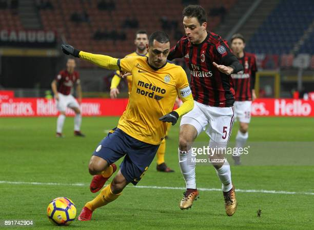 Romulo of Hellas Verona FC competes for the ball with Giacomo Bonaventura of AC Milan during the Tim Cup match between AC Milan and Hellas Verona FC...