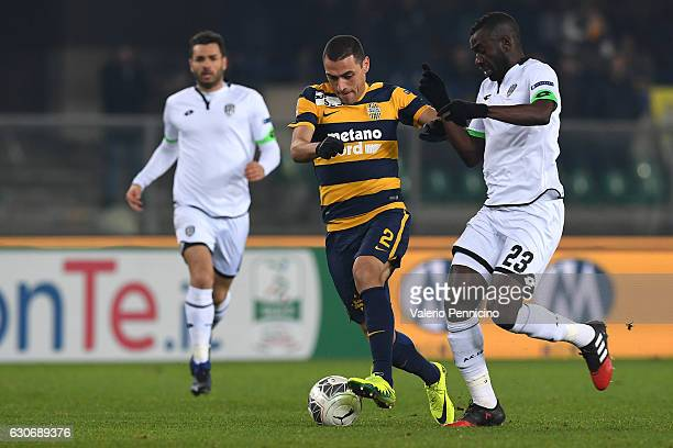 Romulo of Hellas Verona FC competes with Moussa Saib Kone of AC Cesena during the Serie B match between Hellas Verona FC and AC Cesena at Stadio...