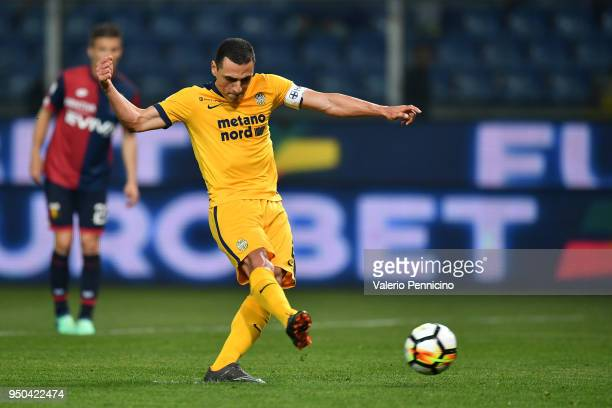 Romulo of Hellas Verona FC scores his goal from the penalty spot during the Serie A match between Genoa CFC and Hellas Verona FC at Stadio Luigi...
