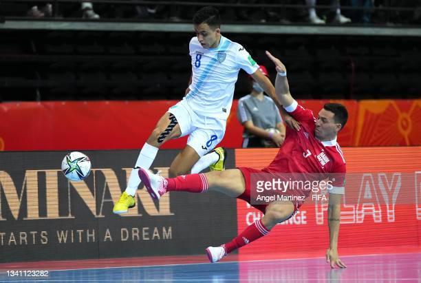 Romulo of RFU and Roman Alvarado of Guatemala challenge for the ball during the FIFA Futsal World Cup 2021 group B match between Guatemala and...