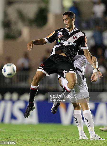 Romulo of Vasco struggles for the ball with a player of ABC during a match as part of Brazil Cup 2011 at Sao Januario stadium on April 06, 2011 in...
