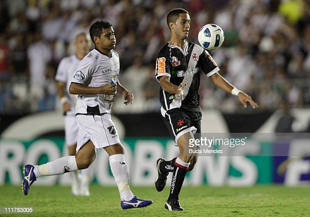 Romulo of Vasco struggles for the ball with Ederson of ABC during a match as part of Brazil Cup 2011 at Sao Januario stadium on April 06, 2011 in Rio...